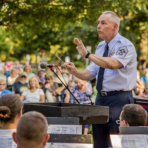 Chief Master Sergeant Phillip Smith leads the 122nd Army Band in the performance of Washington Post in Worthington, Ohio, in August, 2015